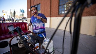 Ric Campos hustles his pedicab business in LoDo during Opening Day at Coors Field. April 1, 2021.