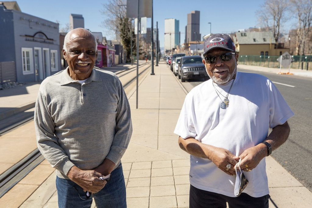 Ralph and Charles Dabney stand on Welton Street in Five Points. April 1, 2021.