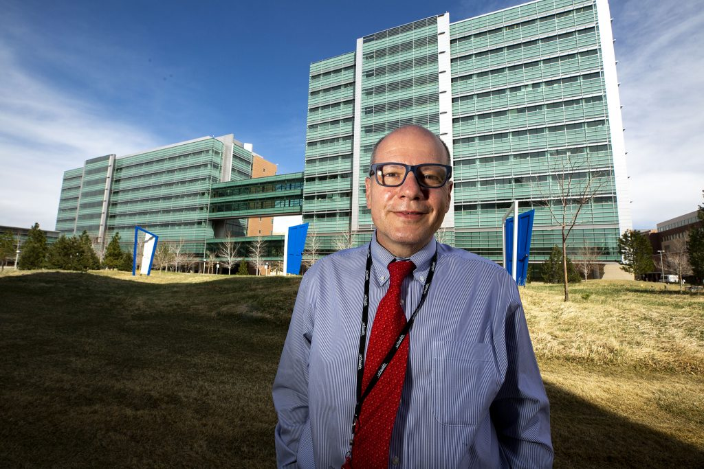 Dr. Fernando Holguin stands in front of the University of Colorado Anschutz Medical Campus building where he works. April 5, 2021.