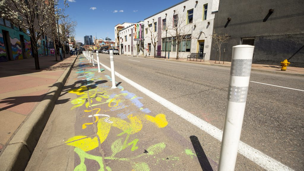 The driving space on Santa Fe Drive was recently  slimmed in favor of more room to walk and roll by its galleries. April 9, 2021.