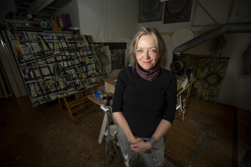 Kelly Austin Rolo stands in her studio above Santa Fe Drive. April 12, 2021.