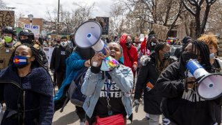 Ashira Campbell leads a protest against police brutality through North Capitol Hill. April 17, 2021.