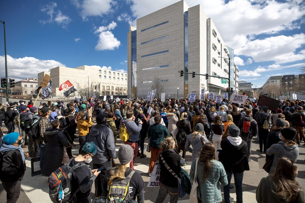 A march led by the Party for Socialism and Liberation stops in front of Denver's downtown jail and courthouse. April 17, 2021.