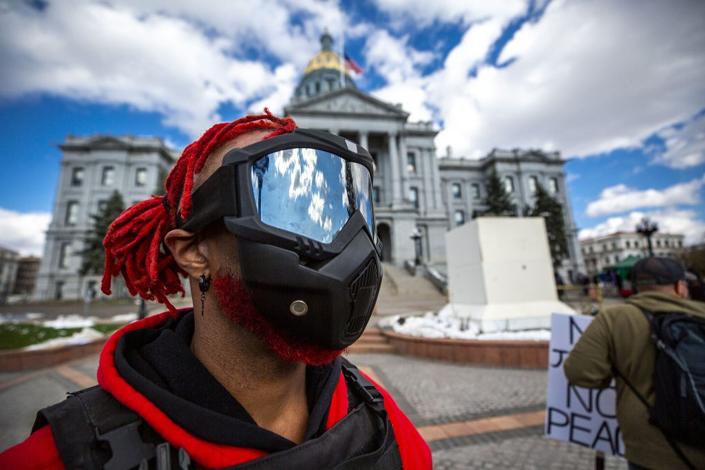 Johnny Redd stands before the Colorado State Capitol after two protests against police brutality. April 17, 2021.