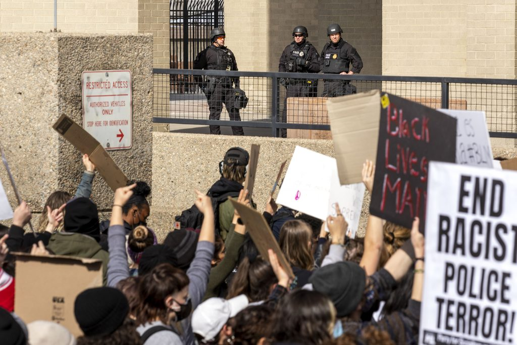 A march against police brutality, led by the Party for Socialism and Liberation, passes Denver Police's downtown headquarters. April 17, 2021.