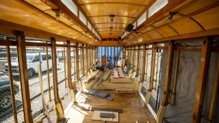 Dave Muggli rehabs some rotten floorboards in the old Denver Trolley, which has sat outside by Confluence Park for three decades. April 22, 2021.