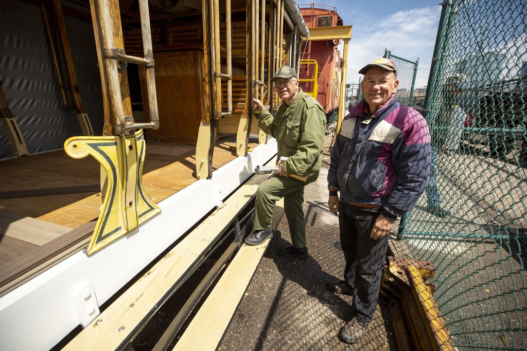 Chuck Mackey and Pete West are two volunteers rehabbing the old Denver Trolley by Confluence Park. April 22, 2021.