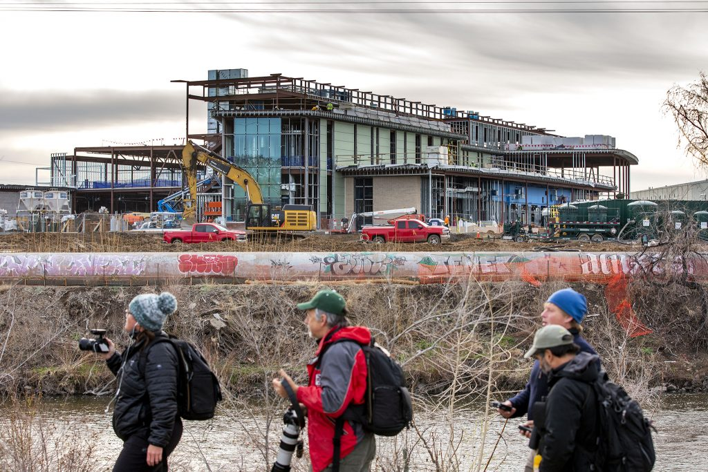 Counters in the third-annual BioBlitz along the South Platte River pass by a CSU educational building in construction on the future National Western Center campus. April 23, 2021.