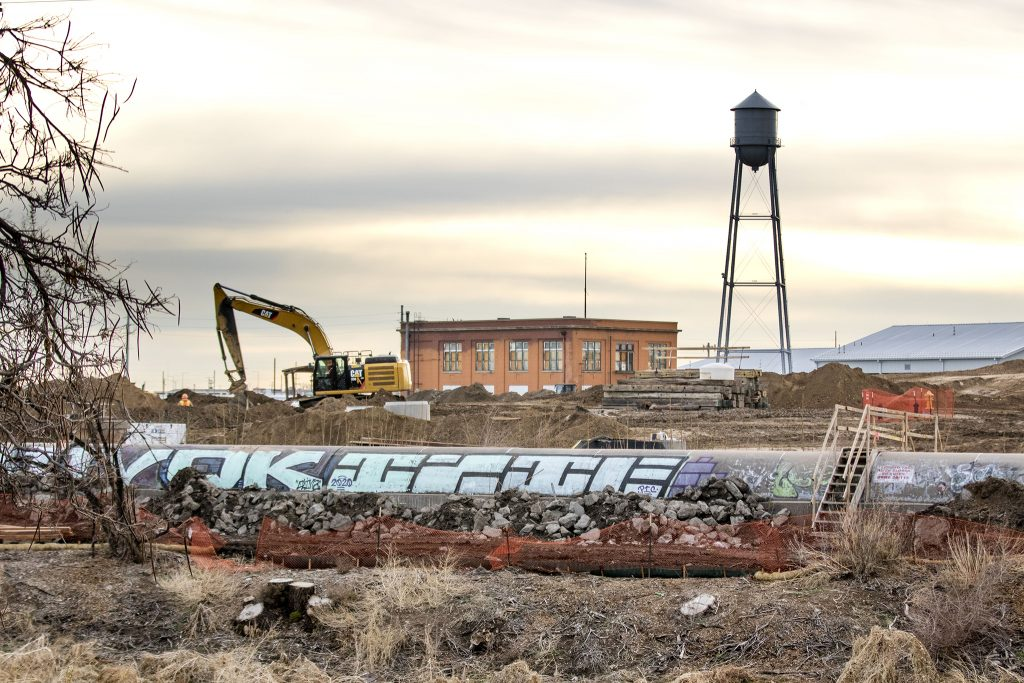 A large sewage pipe will soon disappear from the South Platte's banks as the National Western Center improves access to the river. April 23, 2021.