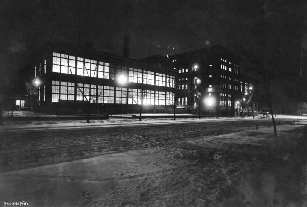 The Old Manual High School during winter's night in Denver, Colorado. Circa 1910.