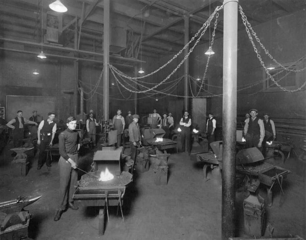 Photograph of an Opportunity Class in Blacksmith at Manual High School in Denver, Colorado. Circa 1910.