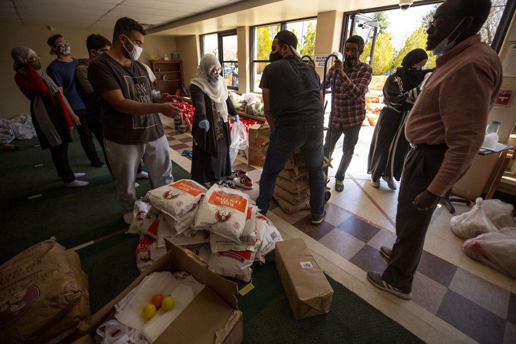 Abir Al-Kabbani leads Colorado Muslim Society volunteers on Parker Road preparing a month-long Ramadan food giveaway.  April 10, 2021.