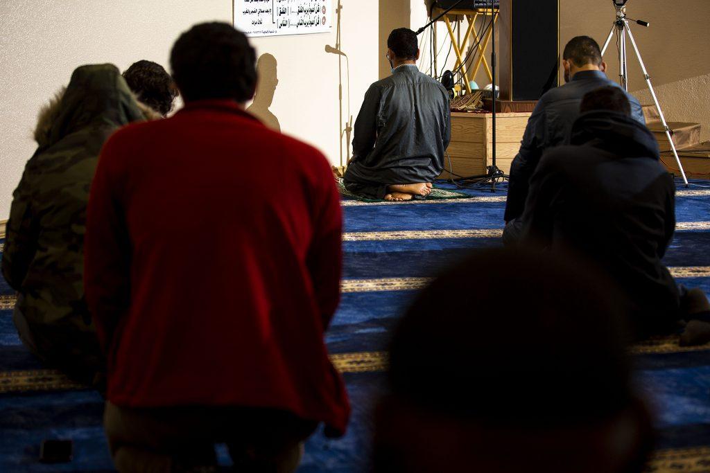 Imam Muhammad Kolila leads the prayer on the first night of Ramadan at the Downtown Denver Islamic Center.  April 13, 2021.