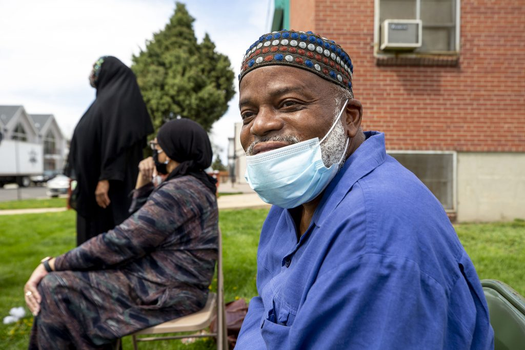 Imam Abdur-Rahim Ali works the weekly food giveaway at the Northeast Denver Islamic Center. May 7, 2021.
