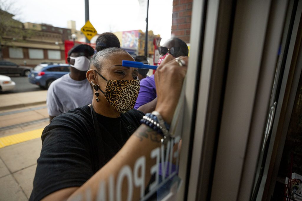 Rhonda Abdullah takes writes orders on a pad against the Welton Street Cafe's front window. May 8, 2021.
