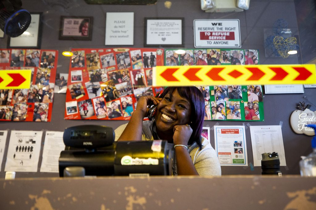 Fathima Dickerson takes orders over the phone behind the Welton Street Cafe's register. May 8, 2021.