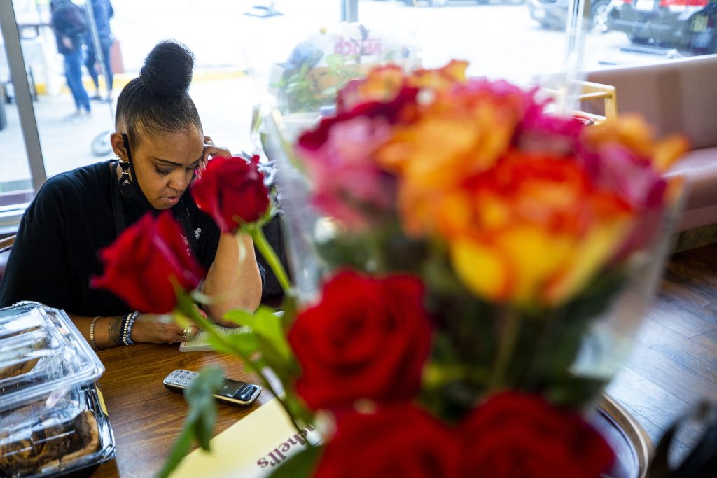 Rhonda Abdullah takes orders at a table inside the Welton Street Cafe. May 8, 2021.