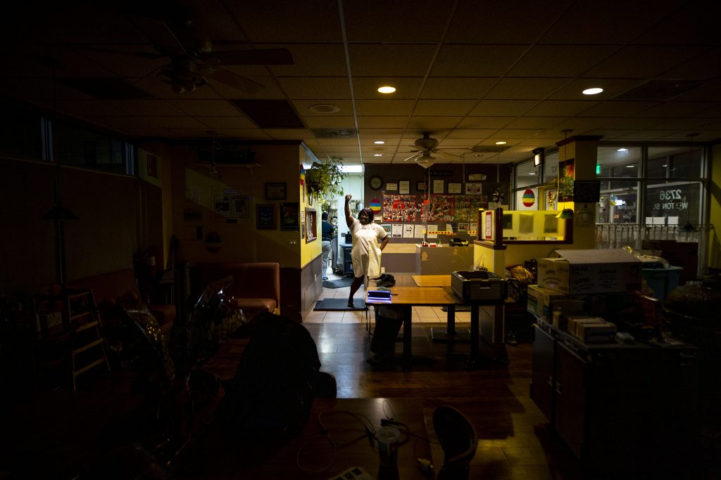 Fathima Dickerson dances as Welton Street Cafe closes for the week. May 8, 2021.