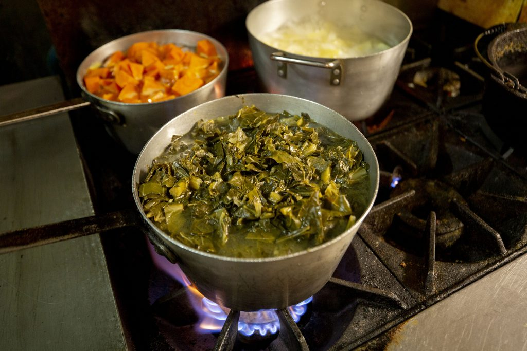 Collards boil on the stove before Welton Street Cafe opens. May 8, 2021.