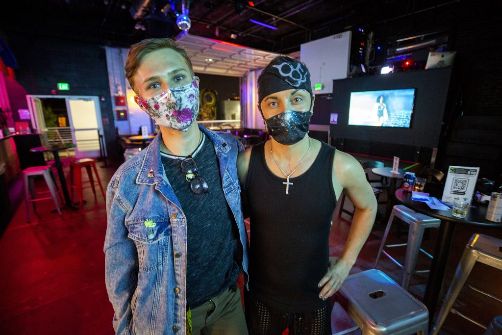 """Jessie Hall (left) came to visit Rufio Jimenez as he worked the bar at Tracks Denver's """"industry night."""" May 12, 2021."""