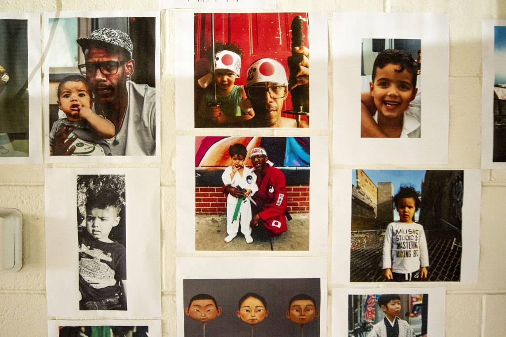 Images of Musa Bailey and his son, Glenn, pasted alongside reference images for his stop motion animation project. May 20, 2021.