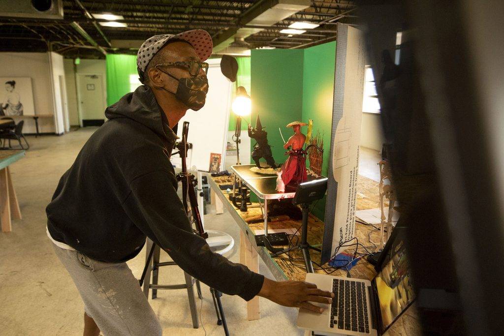 Musa Bailey works on a new stop motion animation project in his Globeville studio. May 20, 2021.