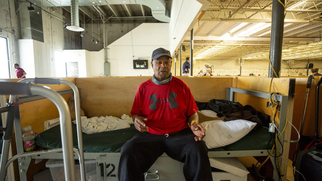 Wiley Brown sits on his bed inside the Salvation Army's Crossroads shelter off Brighton Boulevard in Five Points. May 20, 2021.