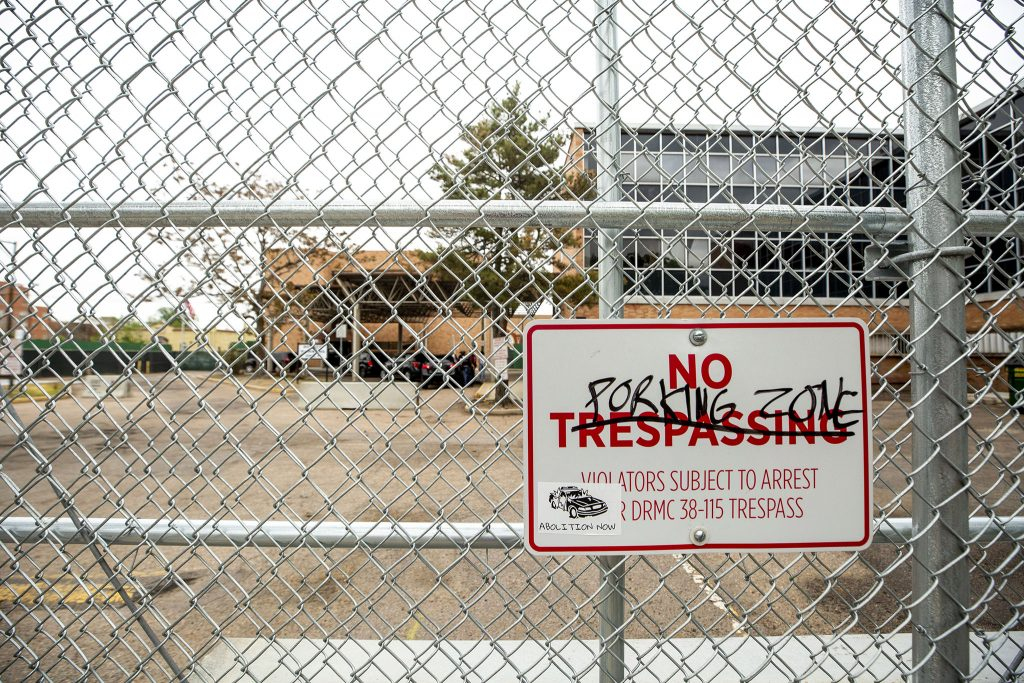 Graffiti on a sign at Denver Police's District 6 headquarters at Washington Street and Colfax Avenue. May 27, 2021.