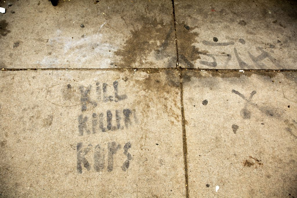 """""""KILL KILLER COPS"""" spraypainted on the side of Colfax Avenue by the Colorado State Capitol. May 27, 2021."""