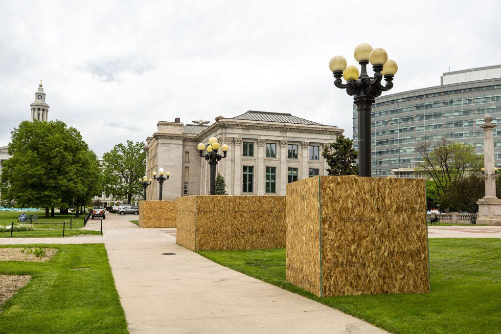 Plywood set up at Civic Center Park for Denver's second Black Love Mural Festival. May 27, 2021.