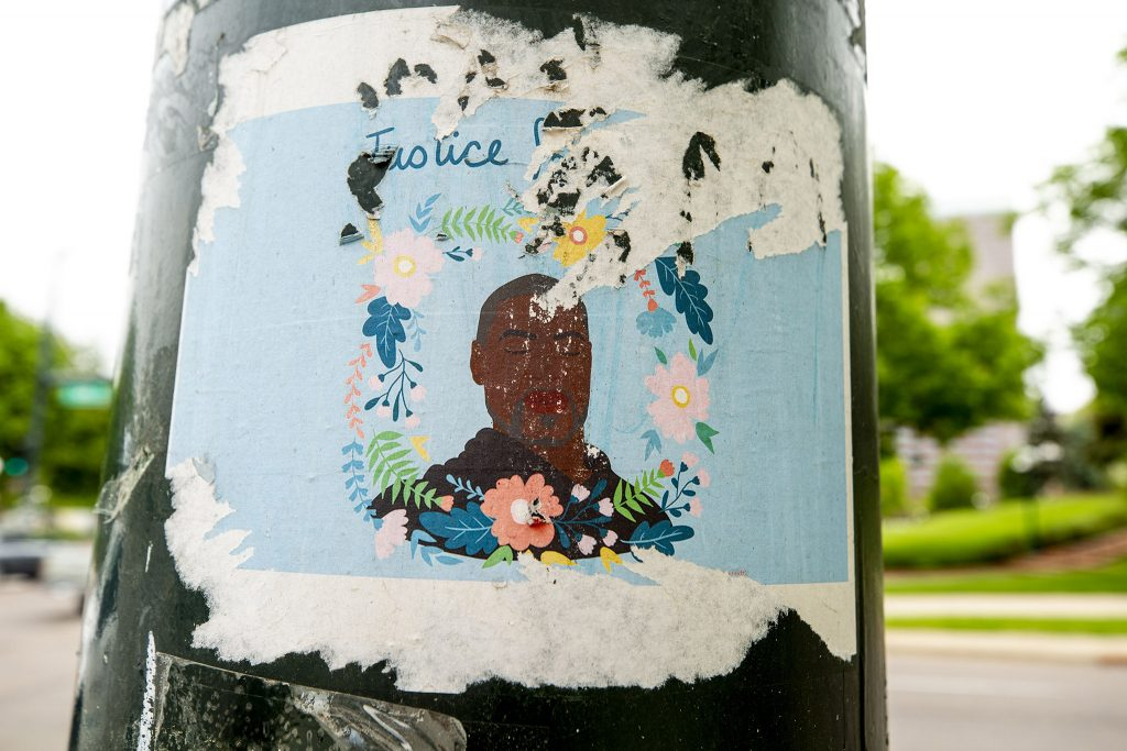 An illustration of George Floyd pasted to a light pole on Broadway by the Colorado State Capitol. May 27, 2021.