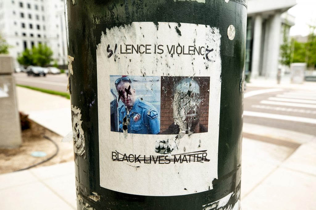 """""""SILENCE IS VIOLENCE,"""" pasted to a light pole on Broadway by the Colorado State Capitol. May 27, 2021."""