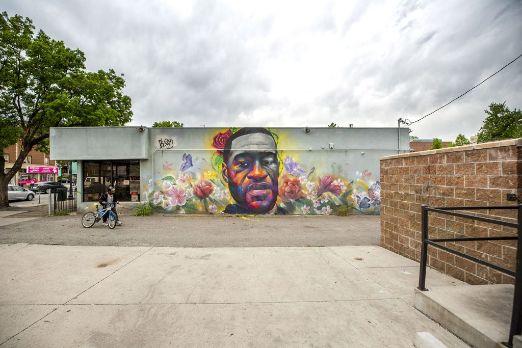 Detour and Hiero's mural of George Floyd painted on a Ready Temporary Services building on Colfax Avenue. May 27, 2021.