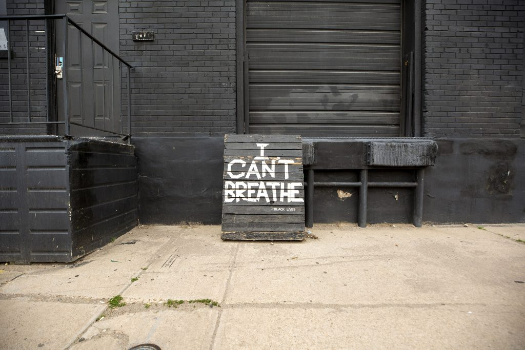 """""""I CAN'T BREATHE"""" painted on a sign off Walnut Street in Five Points. May 27, 2021."""