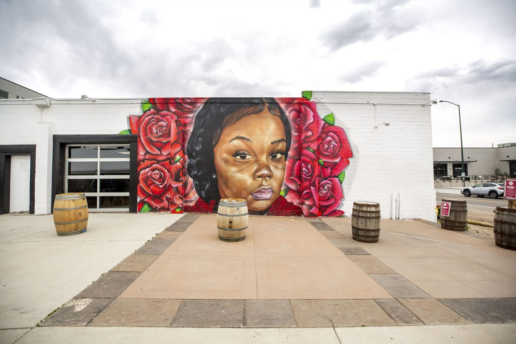 A portrait of Breonna Taylor by Detour and Hiero, painted on the side of the RiNo Co-Op on Walnut Street. May 27, 2021.
