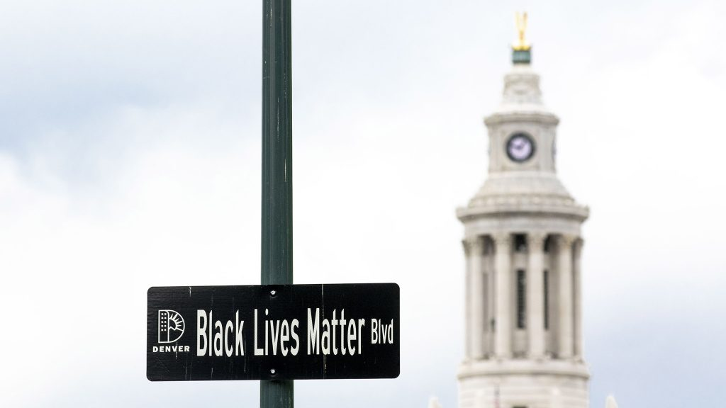 """A """"Black Lives Matter Blvd"""" sign posted above Broadway near the State Capitol. May 27, 2021."""