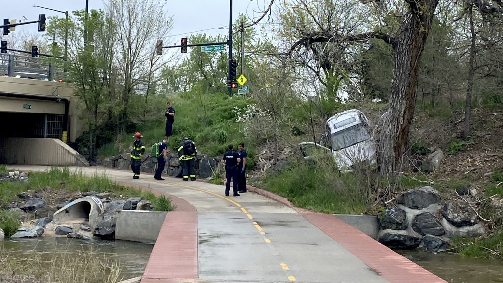 Police and fire crews on the scene of a car crash on the Cherry Creek Trail, where people regularly walk and bike.