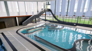 A rendering of the indoor pool coming to Green Valley Ranch Recreation Center. The color of the slides and other amenities has not been solidified.