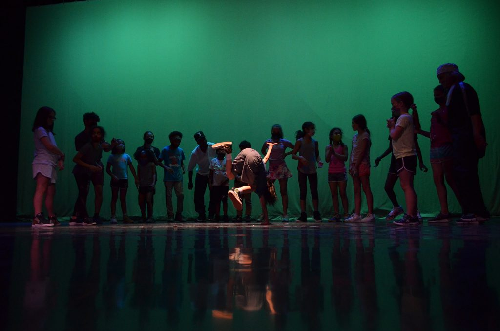 Delaun Willis dances on Cleo Parker Robinson Dance's main stage during the simultaneous STREAM Theatre and Creative Academy programs for kids.