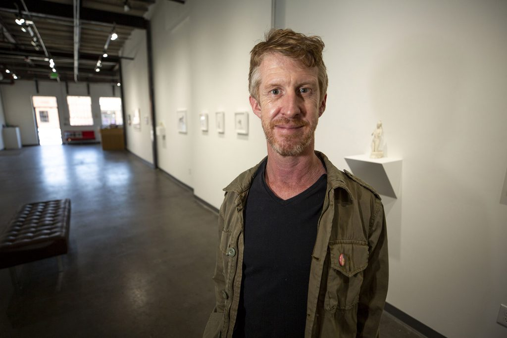 Nathan Larramendy stands inside Visions West Contemporary on Walnut Street in Five Points. June 3, 2021.