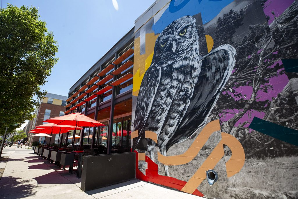 A mural adorns the side of Il Posto on Larimer Street in Five Points. June 3, 2021.