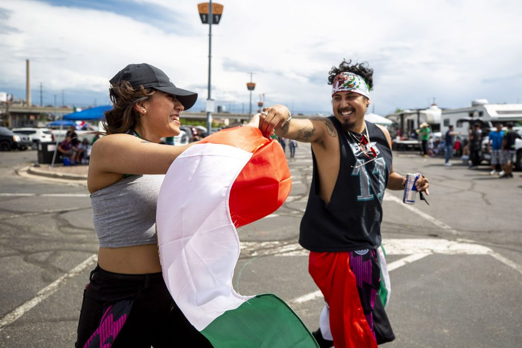 Kana Rodriguez and Rigo Spath dance in Mile High Stadium's parking lot before the U.S. and Mexico national teams face off in the CONCACAF Nations League finals. June 6, 2021.