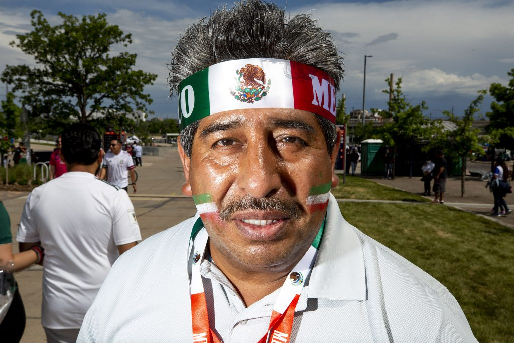 Juan Hernandez sells headbands, flags and face paint before the U.S. and Mexico national teams face off in the CONCACAF Nations League finals at Mile High Stadium. June 6, 2021.