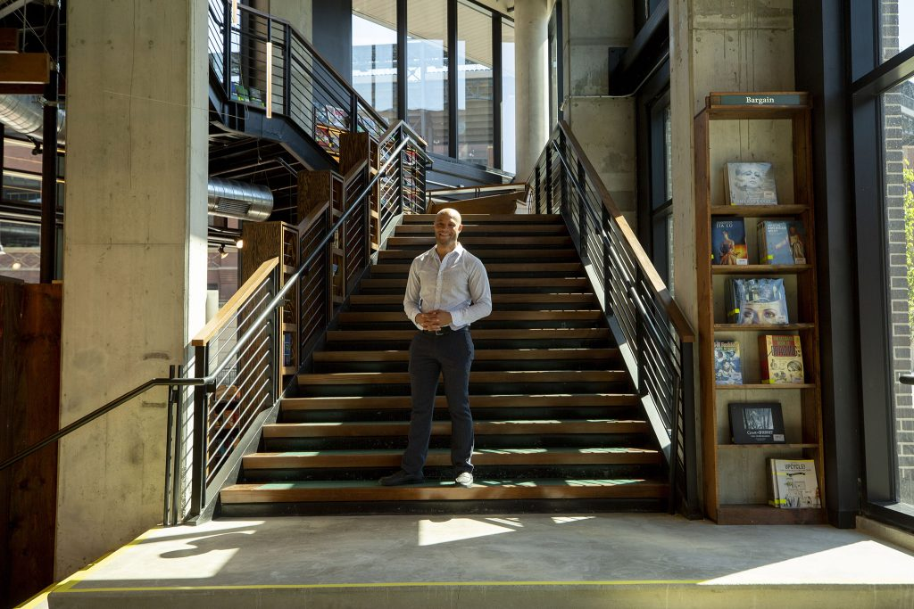 Tattered Cover CEO Kwame Spearman stands in the bookstore's new location at McGregor Square. June 8, 2021.