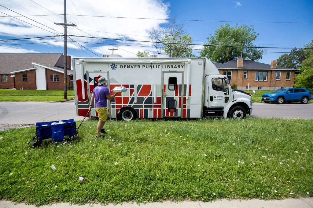 Taylor Charron loads fasteners for Carla Respects Nothing's Indian tacos into the Denver Public Library's book mobile.  06/10/2021.