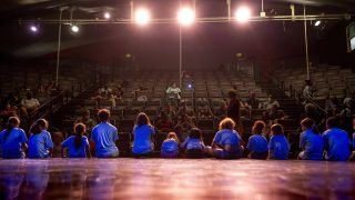 Kids from Cleo Parker Robinson Dance's STREAM Theatre and Creative Academy programs sit on stage in the main theater space. June 11, 2021.