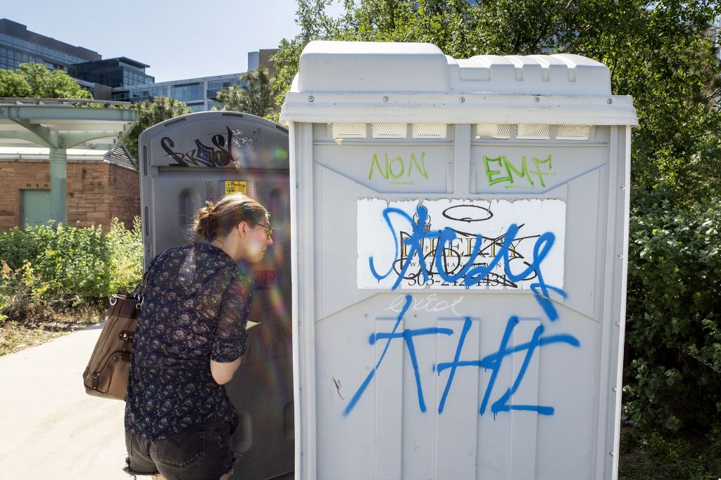 Since the stylish restroom at Commons Park is locked, a portable toilet, decorated by its patrons, is available instead. Intrepid reporter Rebecca Spiess inspected it. June 11, 2021.