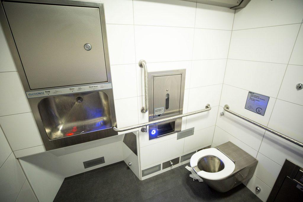 High-tech buttons make the new public restroom at along Champa Street work. June 11, 2021.
