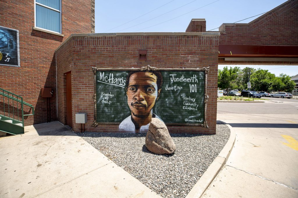 A portrait of Norman Harris III in the Five Points Outdoor Mural Gallery at Five Points Plaza on Welton Street. June 15, 2021.