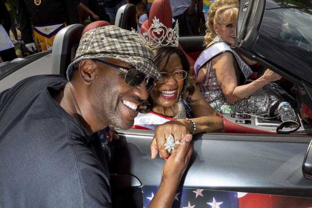 Marilyn Chipman, Ms. Colorado Senior 2021, embraces her son, Michael, as Denver's Juneteenth Parade kicks off. June 19, 2021.